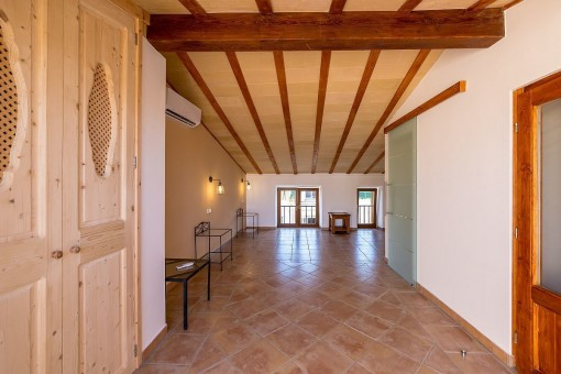 One of 6 bedrooms with wooden ceiling beams
