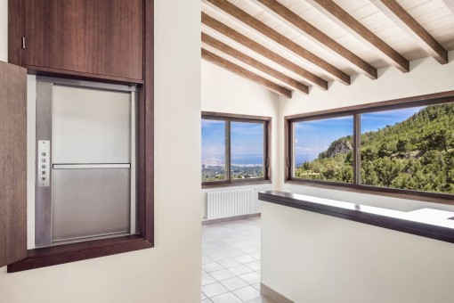 The villa has large panorama windows
