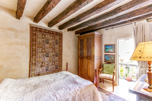 Lovely bedroom with wooden ceiling beams