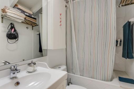The second bathroom with bathtub