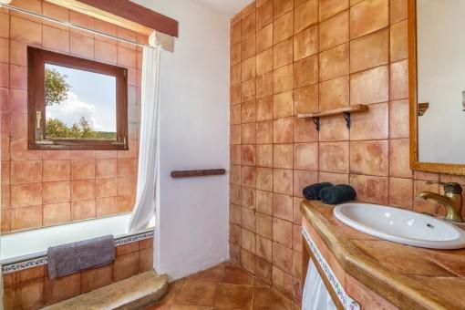 One of three rustic bathrooms of the villa