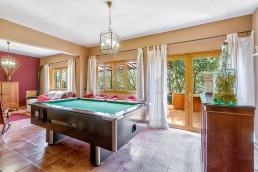 Living area with pool table and access to the terrace