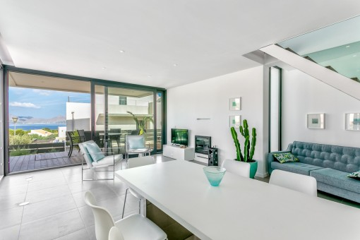 Living and dining area with sea views