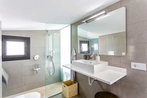 One of 3 modern bathrooms