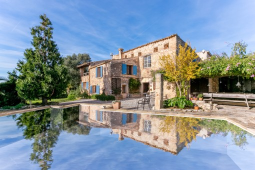 Old renovated manor house with pool between...