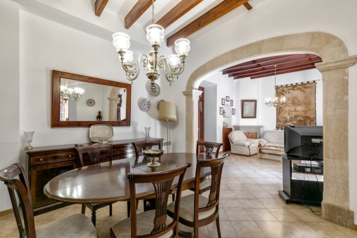 Beautiful stone arch between dining area and living area