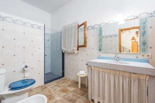 One of 4 bathrooms with shower