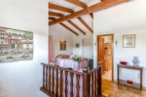Open bedroom on the upper floor