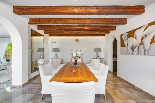 Elegant dining area with wooden beams
