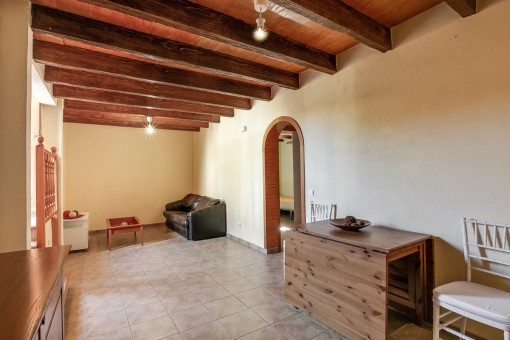 Further room with wooden ceiling beams