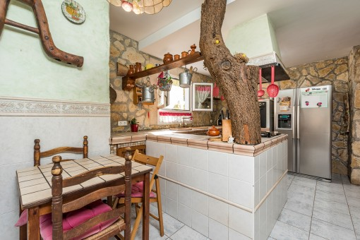 Rustic kitchen with stone wall
