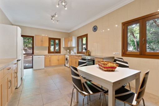 Large kitchen with access to the outside