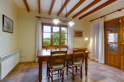 Lovely dining area with wooden ceiling beams