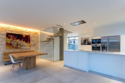 Modern interior summer kitchen with dining area