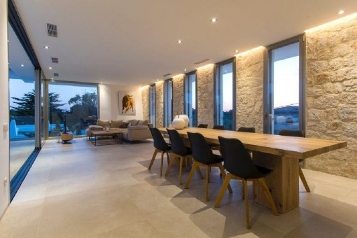 The living and dining area with large glass sliding doors