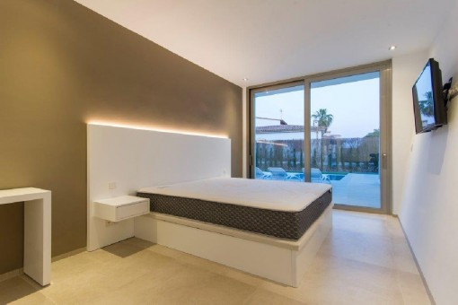 Spacious double bedroom with direct access to the pool area