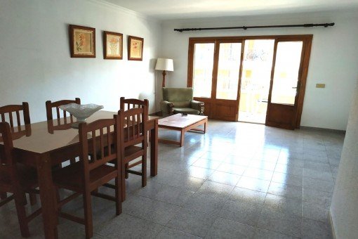 Living and dining area with balcony