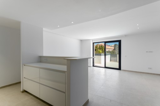 Spacious living area with access to the terrace