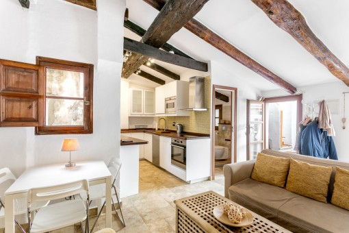 The wooden ceiling beams create a cosy atmosphere