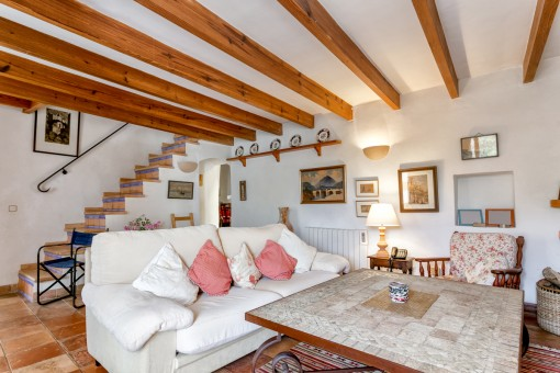 The living area has beautiful wooden ceiling beams