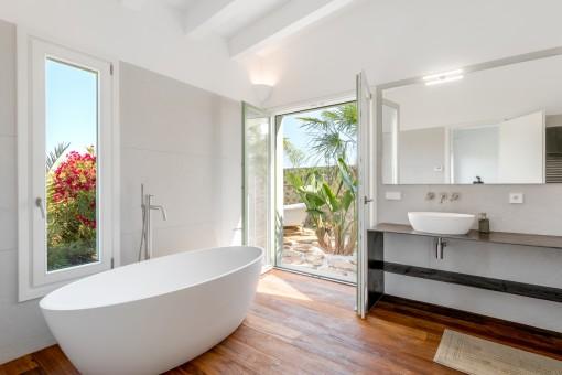 Bathroom with separate outdoor bath tub