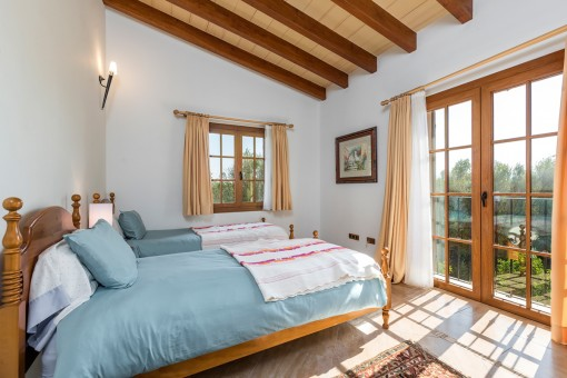 Second bedroom with wooden ceiling beams