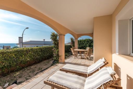 Sunny terrace with sunbeds