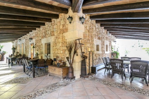 Beautiful, rustic terrace with wooden ceiling beams