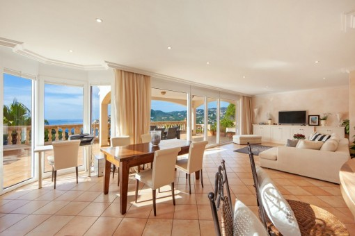 Spacious living and dining area with panoramic windows