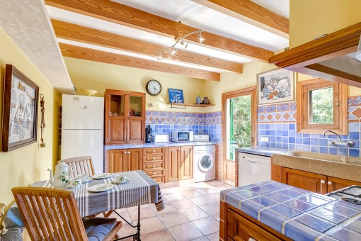 Light-flooded kitchen with integrated laundry
