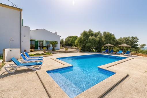 Beautiful pool area with sunbeds