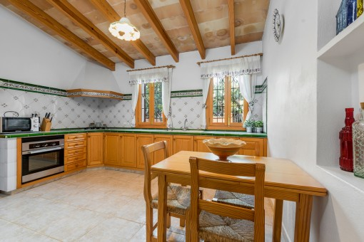 Kitchen and dining area with wooden furniture