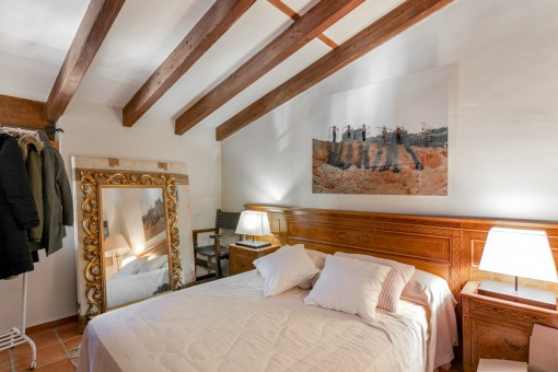 Further bedroom with wooden ceiling beams
