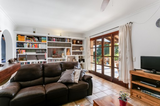 Large living area with access to the terrace