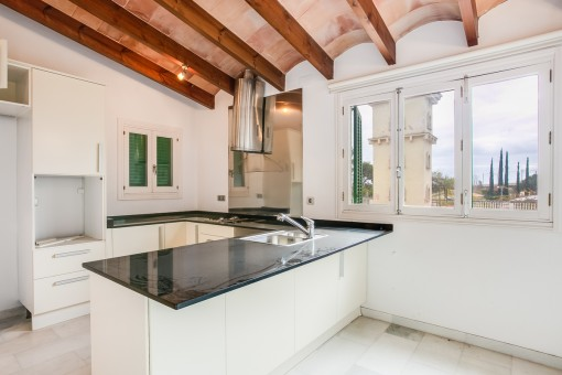 Wonderful kitchen with wooden ceiling beams
