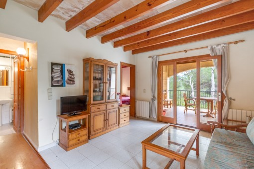 The living area provides wooden ceiling beams