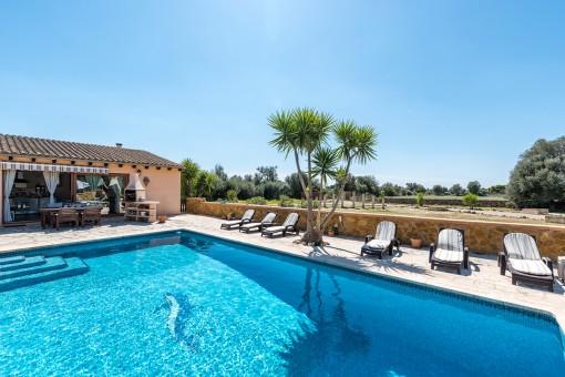 Wonderful pool area with sunbeds