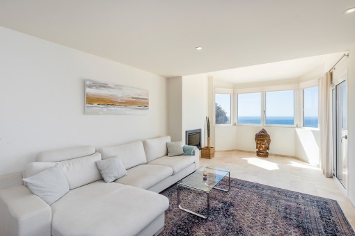 Sea view living area with fireplace