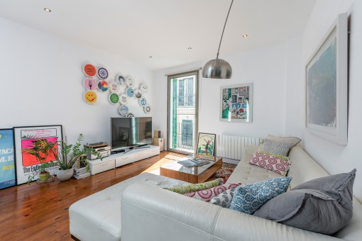 Bright living area with balcony