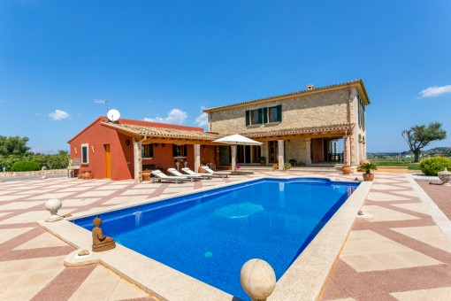 Spacious sun terraces surround the pool