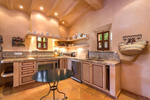 The pool house offers 2 kitchens