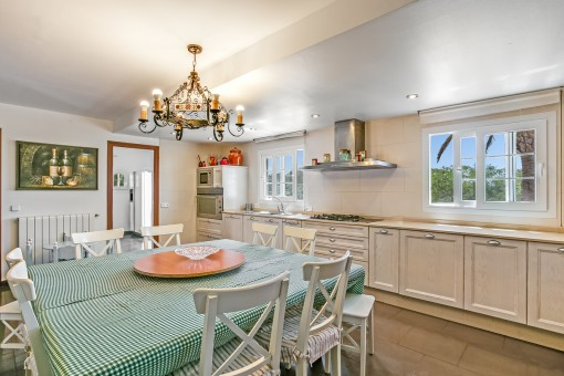 Further dining area with beautiful kitchen