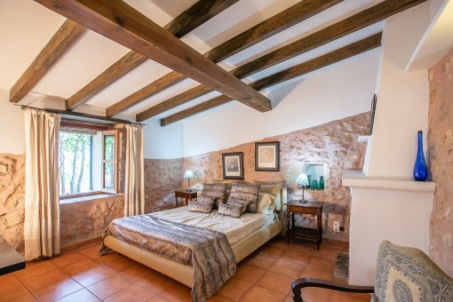Authentic bedroom with sandstone wall