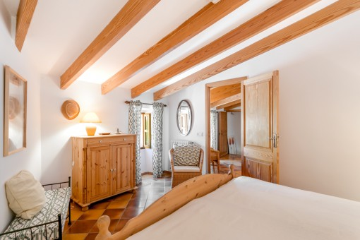 Bedroom with wooden cieling beams