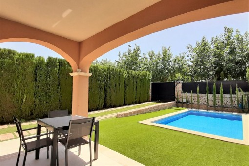 Well-tended garden and pool area