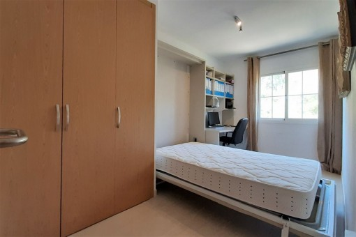 Study room with wall bed