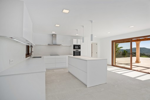 Spacious kitchen with direct terrace access