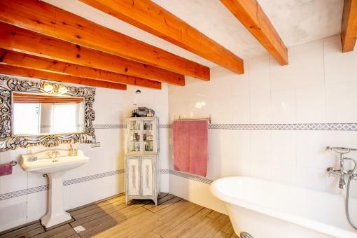 Bathroom including bath tub