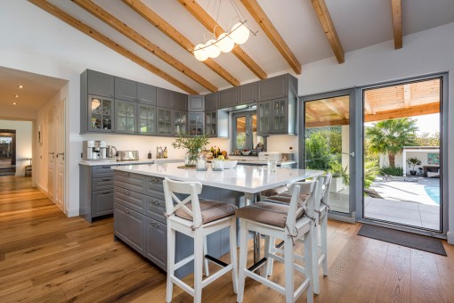 Modern country house kitchen with dining area