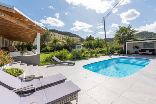 Idyllic pool area next to the garden